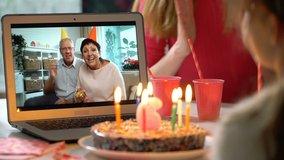 Happy Grandpa and Grandma Congratulate their Grandchildren Happy Birthday Using Laptop Video Call. Social distancing, self isolation during quarantine. Slow motion
