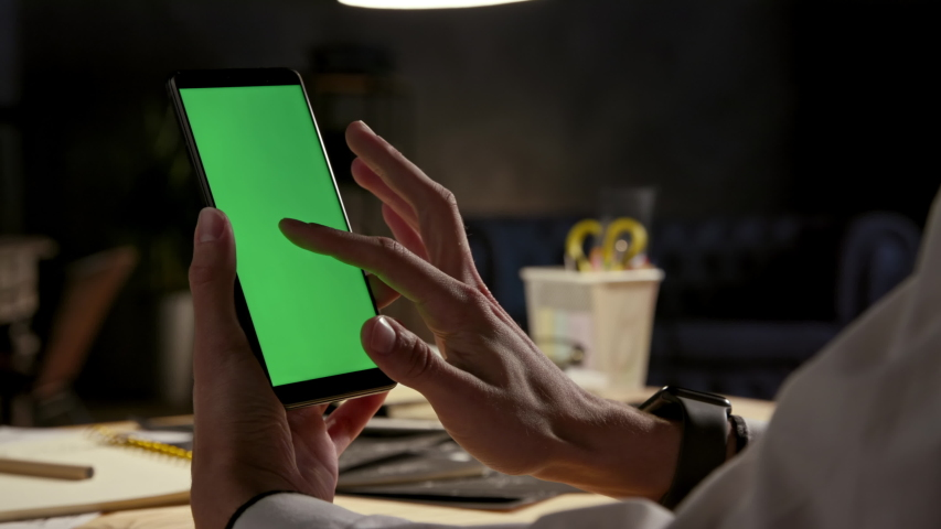 Green Screen and Chroma Key of Smartphone. Tap on Center to Click Closeup. Businessman Using Smart Phone for Work. Office Worker Connects to Chat or Video Conference. Greenscreen of Chromakey Mock-Up Royalty-Free Stock Footage #1051251382