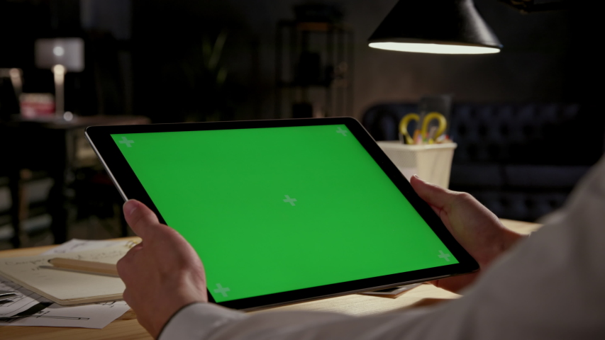 Green Screen and Chroma Key of Tablet Computer. Business Man Holding Mobile PC and Working Closeup. Greenscreen of Chromakey Mock-Up with Tracking Markers. Office Worker Searching Content at Web Blog | Shutterstock HD Video #1051251388