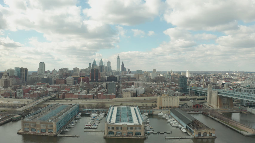 Aerial Drone Shot of Philadelphia Downtown Skyline From Over Waterfront | Shutterstock HD Video #1051253473