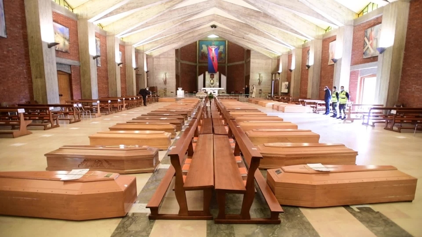 Seriate, Italy - March 28, 2020: coffins of deceased people are lined up inside the San Giuseppe chapel waiting to be transfered to other cities to be cremated amid Covid-19 coronavirus outbreak.
