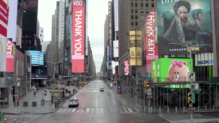NEW YORK - APR 25, 2020: Times Square street empty with one car on road during coronavirus COVID-19 pandemic quarantine lockdown in Midtown Manhattan New York City NYC.