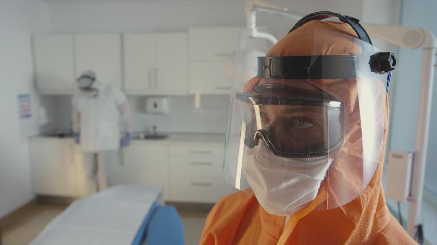 Frontline Coronavirus Doctor in Hazmat Suit Taking a Deep Breath    Shutterstock HD Video #1051298257