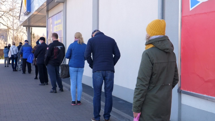 Coronavirus Pandemic Concept. Long Queue To Enter The Supermarket For Grocery Shopping. Bialystok, Poland - March 2020.