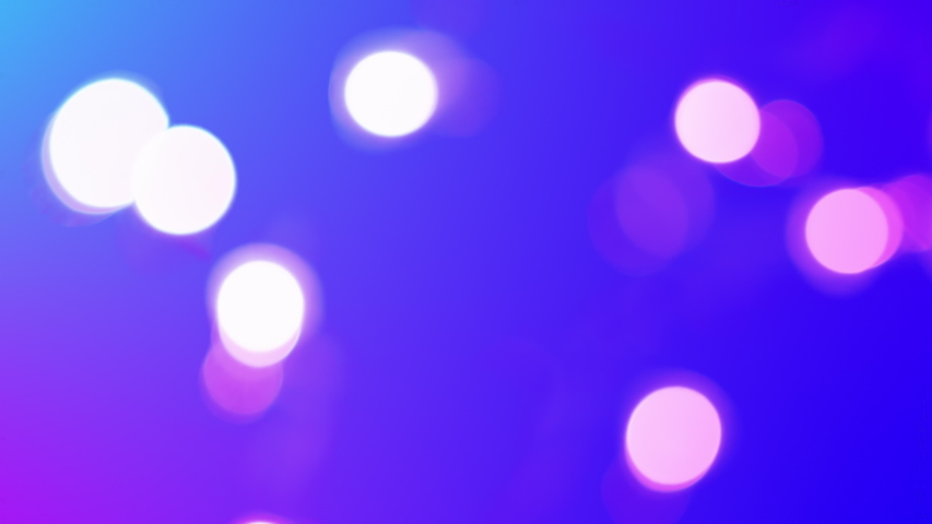 Blue and purple bokeh. Shot with real lens and then colored. Perfect overlay or background. Abstract lovely colors. | Shutterstock HD Video #1051336837