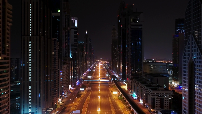 Aerial view of empty streets due to the coronavirus pandemic in Dubai, United Arab Emirates | Shutterstock HD Video #1051341649