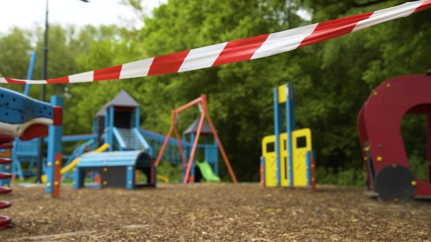 Empty children's playground in a public park in Szentendre, Hungary. European deserted street. Gimbal, steadicam smooth 4K shot.   Shutterstock HD Video #1051363447