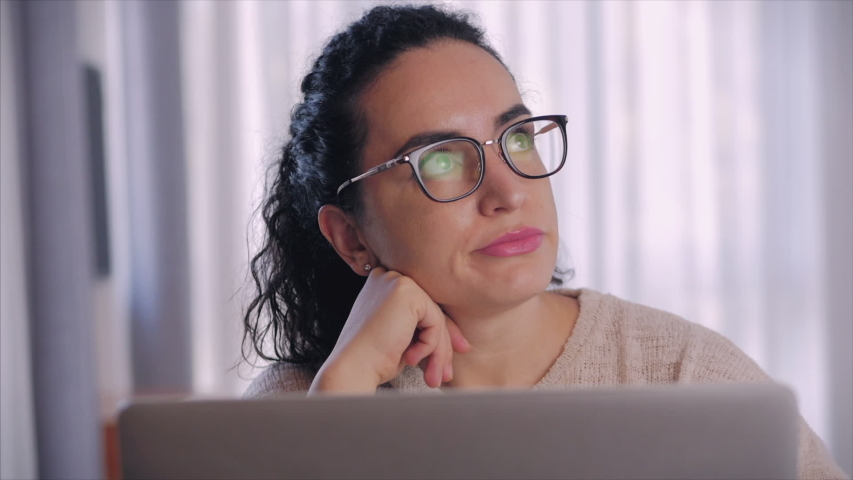 Freelancer concerned thoughtful caucasian woman working on laptop computer looking away thinking solving problem at home office, serious woman search for inspiration make decision feel lack of ideas. Royalty-Free Stock Footage #1051372447