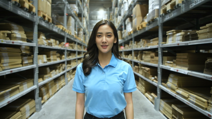 Business concepts. Asian women are smiling with confidence in the warehouse. 4k Resolution. Royalty-Free Stock Footage #1051477096
