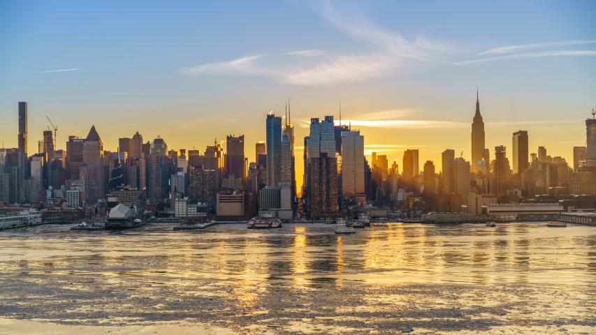 Midtown Manhattan skyline at sunrise in New York, timelapse of rising sun | Shutterstock HD Video #1051486147