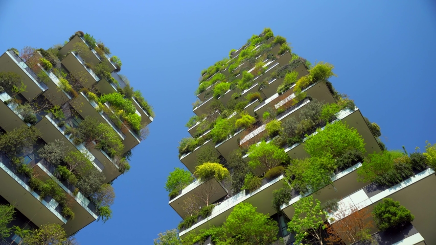 Milan, Italy, April 19, 2020: modern and ecological skyscrapers with many trees on each balcony. Bosco Verticale. Modern architecture, vertical gardens, terraces with plants. Green Planet. Blue sky