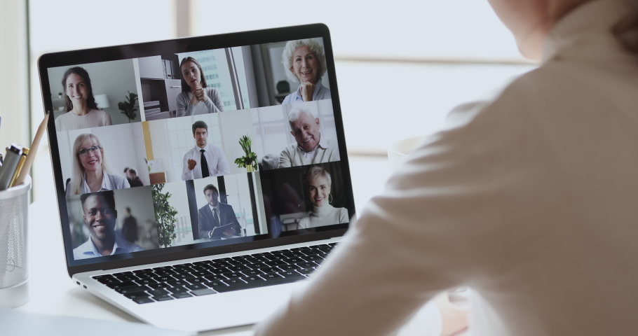 Video conference concept. Multiracial business team people communicate by web cam. Over shoulder view of distance employee at remote virtual online group meeting by video call working from home office | Shutterstock HD Video #1051488616