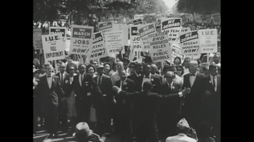 CIRCA 1963 - Civil rights leaders A. Philip Randolph, Roy Wilkins, Walter Reuther, and Martin Luther King lead the March on Washington.
