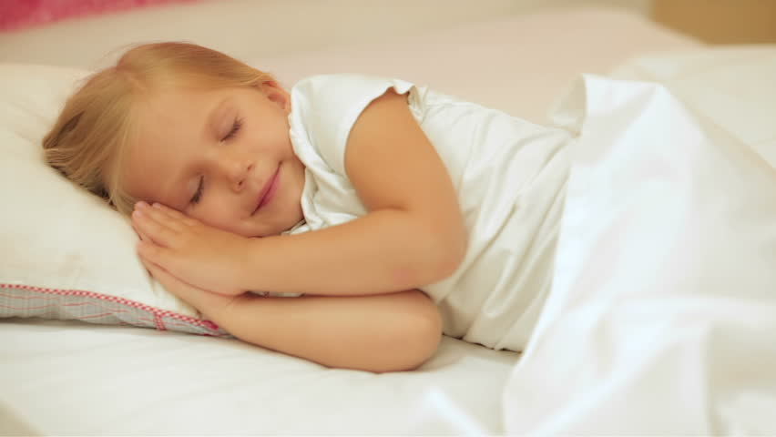 Adorable little girl sleep in the bed at home | Shutterstock HD Video #10515113