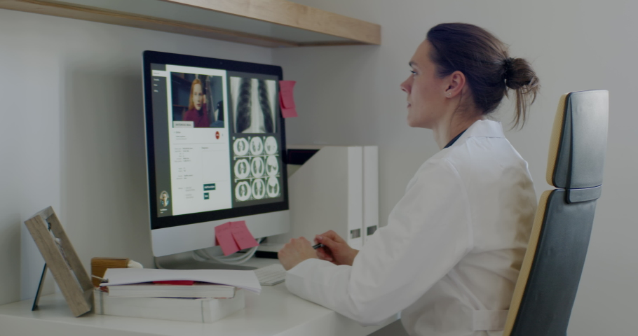 FIXED Caucasian female doctor delivering telemedicine consultation to a patient. Telehealth, telemedicine, remote consultation service. Coronavirus, COVID-19 Royalty-Free Stock Footage #1051515103