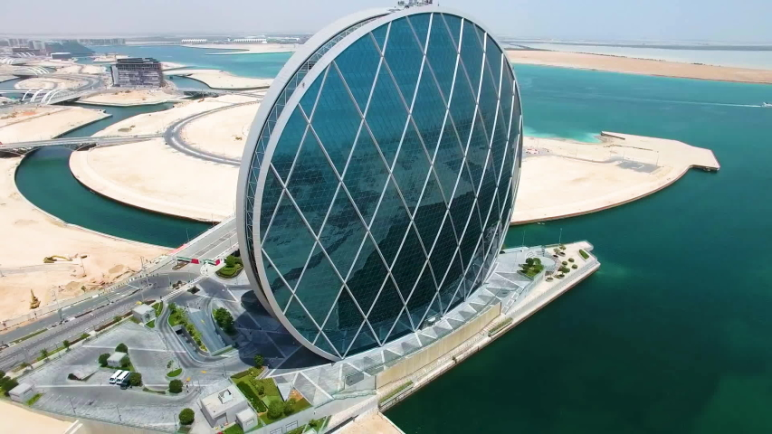 ABU DHABI, UAE - CIRCA MARCH 2018: Aerial view of circular skyscraper Aldar Headquarters Building in Abu Dhabi, UAE. It is the first circular building of its kind in the Middle