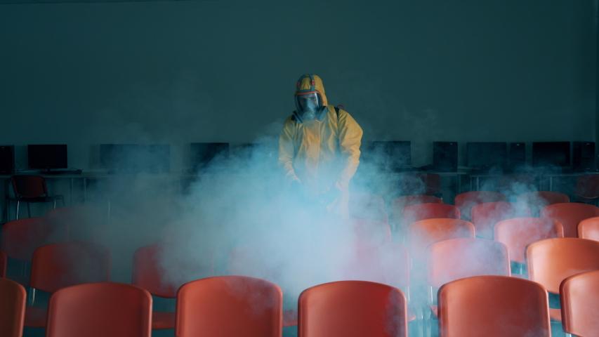 Sanitation expert is fumigating quantorium hall Royalty-Free Stock Footage #1051552942
