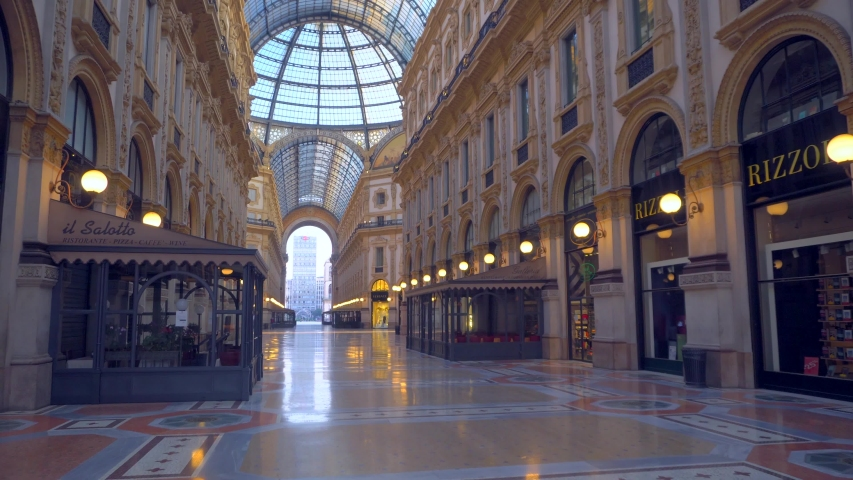 Milan, Italy, April 22, 2020: Vittorio Emanuele Gallery is empty of people and a tourist. Piazza Duomo. The quarantine from Covid19 in Italy. Quarantine in Milan. Closed luxury shops, bar, restaurants