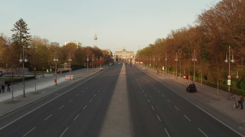 AERIAL: Empty Brandenburger Tor in Berlin, Germany due to Corona Virus COVID19 Pandemic in Sunset Light | Shutterstock HD Video #1051556713
