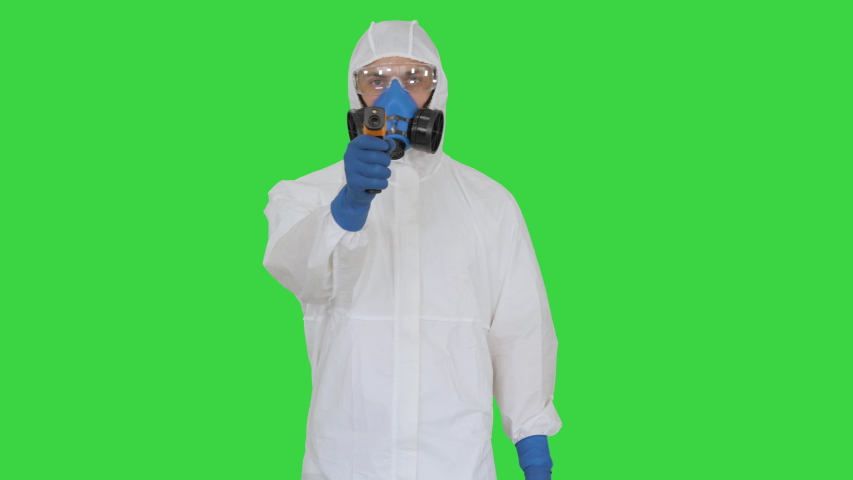 Doctor in protective suit checking your temperature on a Green Screen, Chroma Key. Royalty-Free Stock Footage #1051575331
