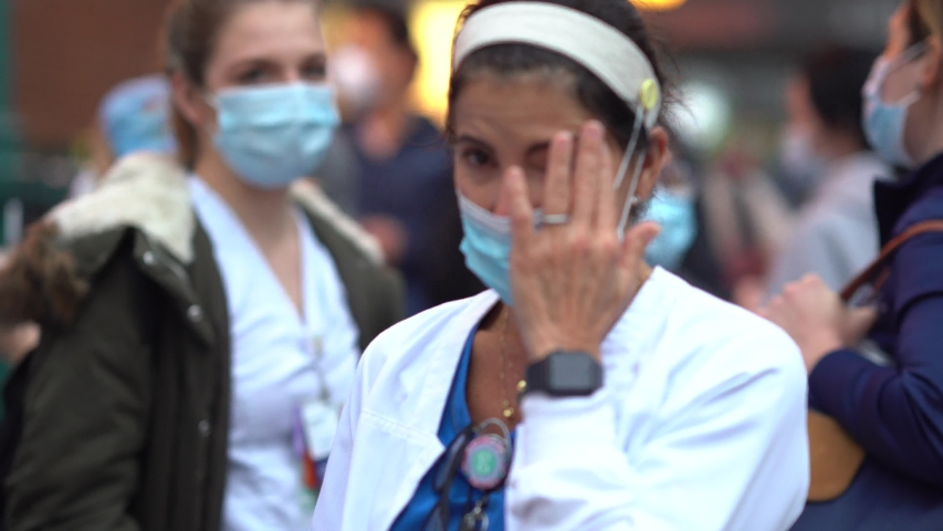 New York City, New York / USA - May 1 2020: New York hospital healthcare workers and nurses clapping expressing gratitude for saving lives during pandemic coronavirus outbreak in New York City, 7pm