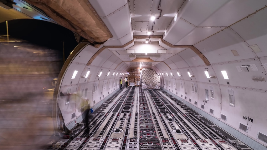 Loading air cargo inside aircraft cargo hold loop Royalty-Free Stock Footage #1051606438
