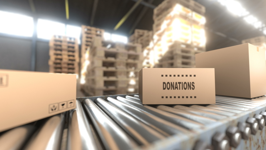 A huge hangar where cardboard boxes with donation and humanitarian aid are stored. When it is time to shipping the boxes are loaded on a conveyor belt to the transport that will delivering the goods.
