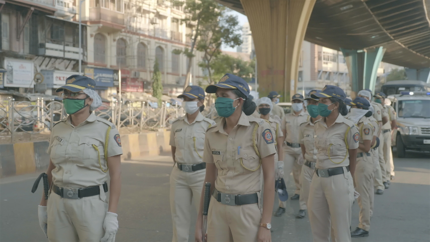 Women/ ladies/ female police force/ constables/ personals wearing face masks standing on the road conducting  public awareness rally during Covid19/ Coronavirus pandemic , Mumbai, India (April 2020)