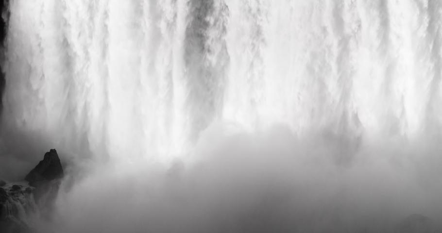 NIAGARA FALLS, NEW YORK - 8 AUG 2019: Niagara Falls at night water multi colored lights waterfall. International border USA New York and Canadian province Ontario. honeymoon vacation destination.