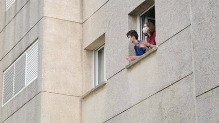 Caucasian people in medical mask applauding in window from apartment. Family supporting of medical staff, health workers, Coronavirus pandemic in Europe, Spain, Italy. People clapping hands. 4k video.
