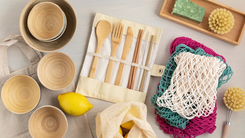 Stop motion animation of Zero waste kit. Set of eco friendly bamboo cutlery, mesh cotton bag, reusable coffee tumbler, brushes and water bottle. Sustainable, ethical, plastic free  Royalty-Free Stock Footage #1051641643