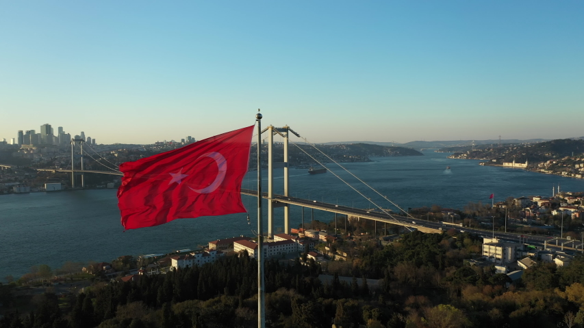Aerial view of Empty Istanbul Bosphorus Bridge and Turkish Flag. No People. 15 July Martyrs Bridge without people. Quarantine days. 4K Footage in Turkey