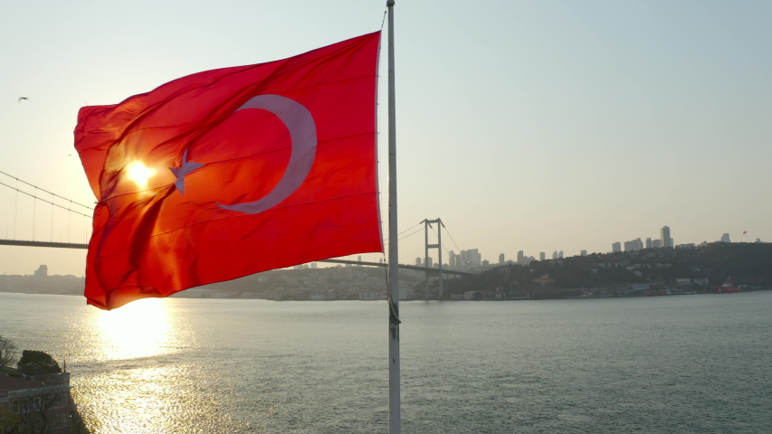 Aerial view of Istanbul Bosphorus and Turkish Flag.Istanbul Bosphorus Bridge (15 July Martyrs Bridge) and Historical Peninsula Landscape. 4K Footage in Turkey.  | Shutterstock HD Video #1051649986