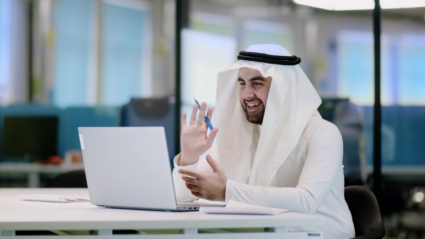 Arab businessman video call in arabic style. Business success concept. Communication online video call concept. Businessmen communication. Video chat.
