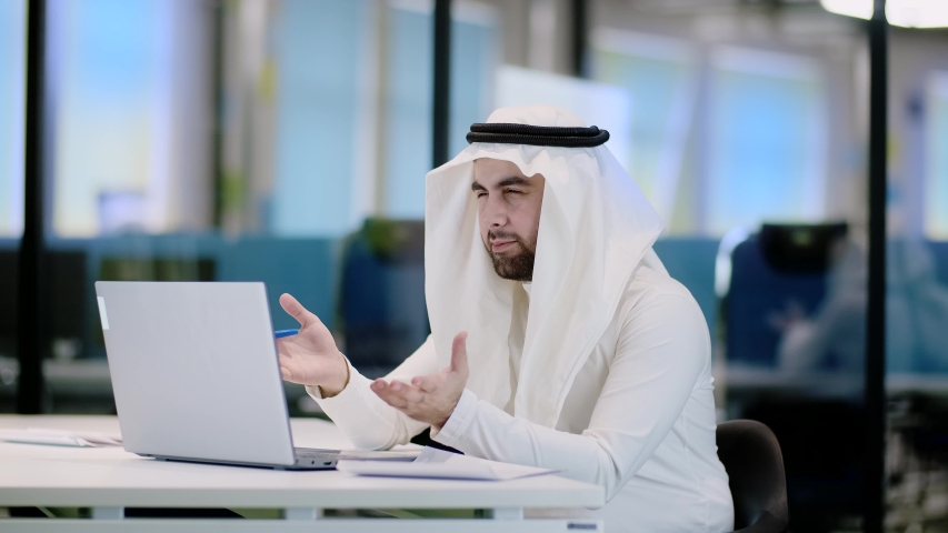 Arab businessman video call for web design. Teamwork concept. Mobile internet. Web icon. Smart city. | Shutterstock HD Video #1051659325
