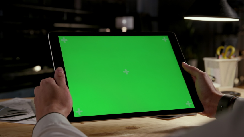 Green Screen and Chroma Key of Tablet Computer. Business Man Holding Mobile PC Close-Up. Greenscreen of Chromakey Mockup with Tracking Markers. Office Worker Shopping at Web Store or Working on Pad