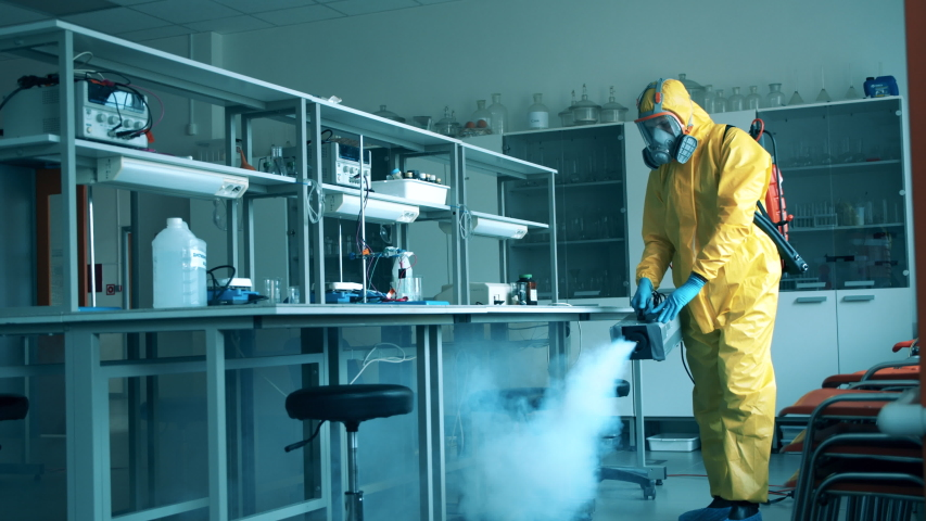 Chemical fumigation of a quantorium done by a disinfector Royalty-Free Stock Footage #1051681735