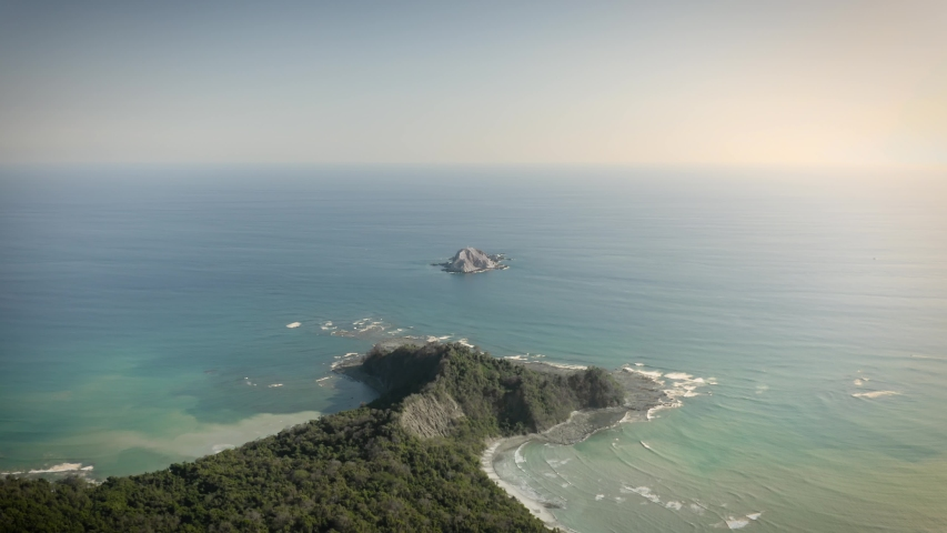 Cabo Blanco Island and National Park from the sky, costa rica end of the world finisterra. Amazing clear sea of the absolute reserve | Shutterstock HD Video #1051693504