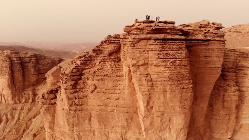 Aerial of The Edge of the World (Jebel Fihrayn) is an unexpected and dramatic geological wonder in the rocky desert northwest of Riyadh, Saudi Arabia