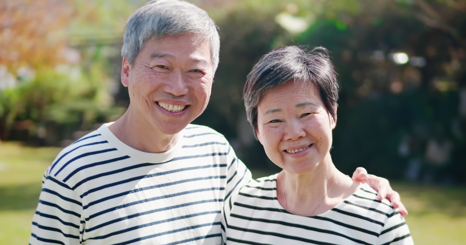 Asian elderly couple smile at you happily Royalty-Free Stock Footage #1051718761