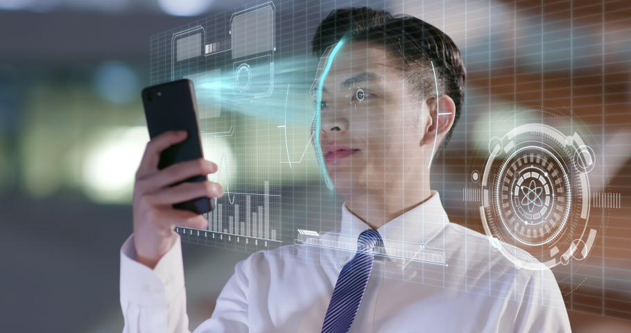 businessman use facial recognition system by smartphone at night in the office Royalty-Free Stock Footage #1051720174