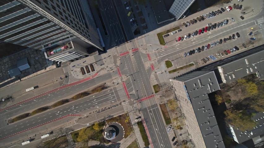Vertical view of empty road intersection in Warsaw City Center, Emili Plater and Świetokrzyska street.  Shoted in 5.2K CDNG, Warszawa, Poland, Polska | Shutterstock HD Video #1051732582
