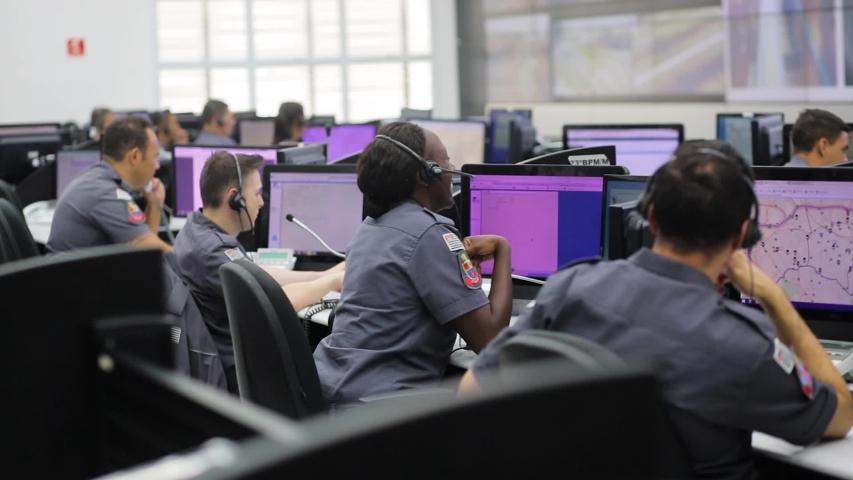 Sao Paulo / Brazil - March 2020: police emergency dispatcher respond emergency call center in sao paulo brazil copom
