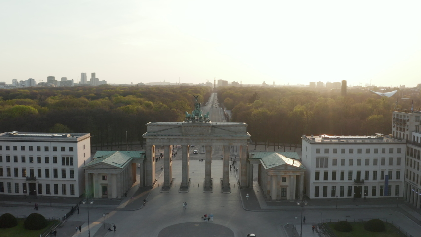 AERIAL: Over Brandenburger Tor with almost no People in Berlin, Germany due to Corona Virus COVID19 Pandemic in Beautiful Sunset Light | Shutterstock HD Video #1051746964
