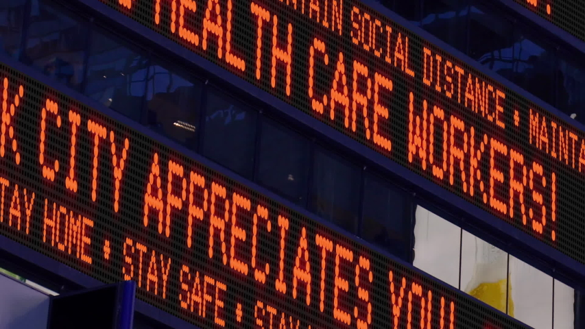 A fictional Times Square stock market ticker thanks health care workers during the COVID-19 pandemic of 2020. Custom messages available upon request.   | Shutterstock HD Video #1051764733