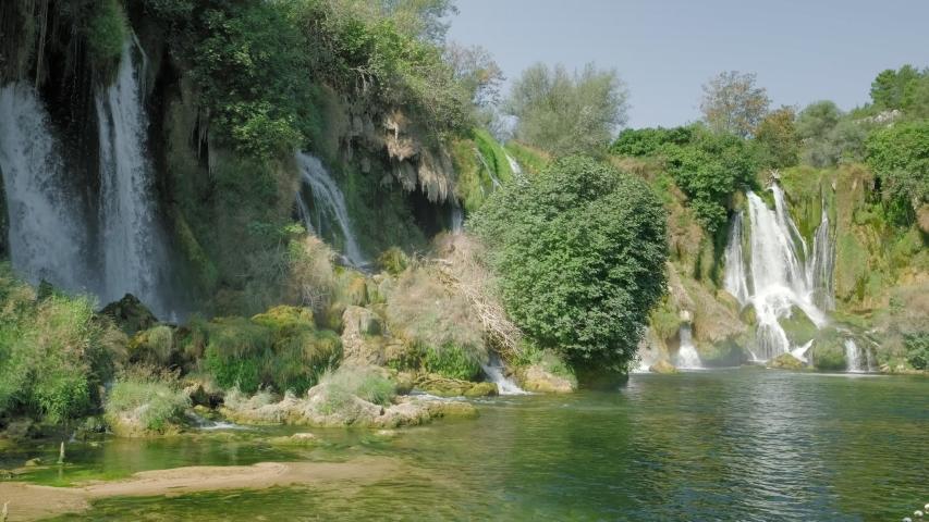 Panning shot of Kravica waterfall on Trebizat river in Bosnia and Herzegovina.
