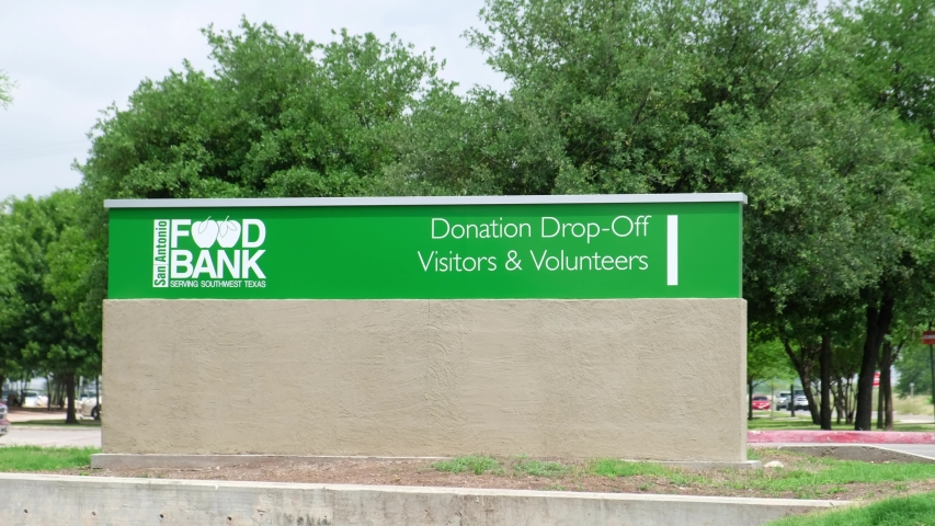 SAN ANTONIO, TEXAS - 04/28/2020 - Sign at the entrance of Food Bank on a sunny day.