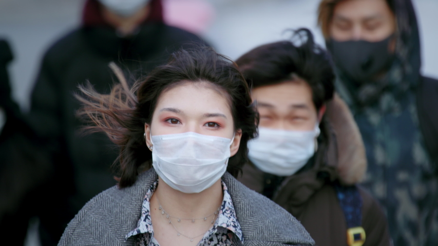 Asian people go walk. Asia corona virus mers. City street outdoor. Covid-19. Chinese man in face mask public. Epidemic coronavirus. Masked crowd quarantine. Pandemic corona virus. Covid 19 china. Royalty-Free Stock Footage #1051780411