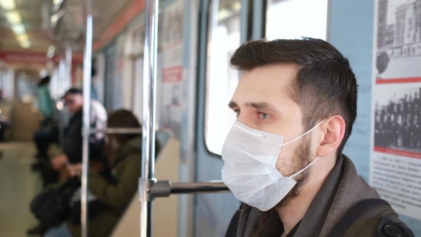 Corona Virus Mers. Man in Face Mask for Covid-19. Subway Station. Epidemic Coronavirus. Pandemic Flu Corona Virus. Masked Human 2019-Ncov. Train Metro. People Covid 19. Royalty-Free Stock Footage #1051783558