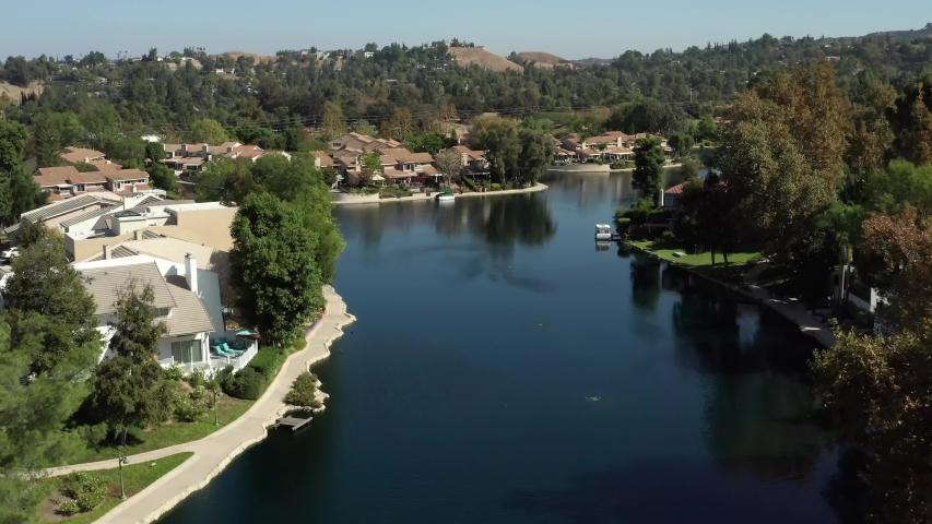 Calabasas, California / USA - 12 07 2020 Drone flyover Calabasas lake and homes of rich and famous | Shutterstock HD Video #1051785463